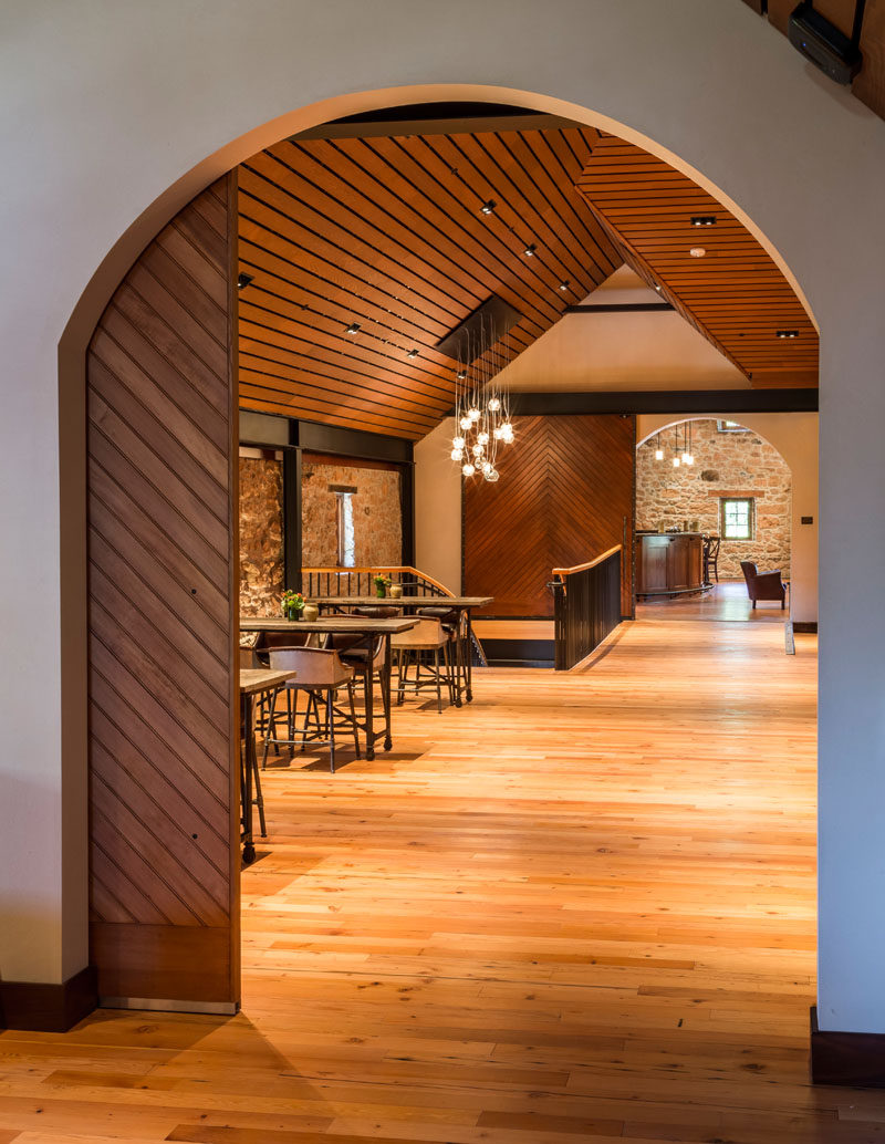 Crisp white walls and wooden ceilings and doors create contrast in the space, and specially designed steel trusses add a touch of drama.