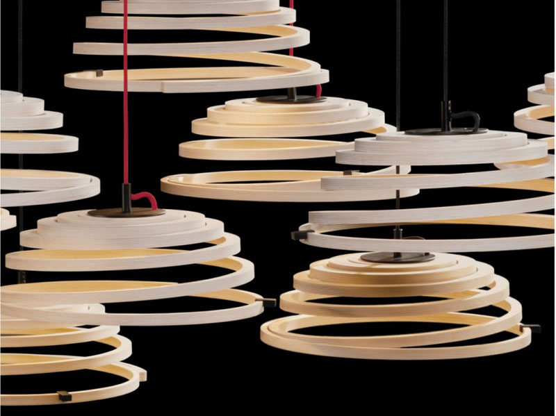 15 Wood Pendant Lights That Add A Natural Touch To Your Decor // These lights are fashioned from thin strips of cut wood that become a spiral design.