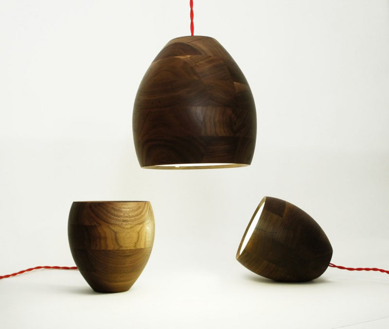 15 Wood Pendant Lights That Add A Natural Touch To Your Decor // These versatile lamps use wood pieces with inconsistent wood grains to create unique lights that can hang as pendants or sit on their side or bottom, to create different looks depending on where you want them.