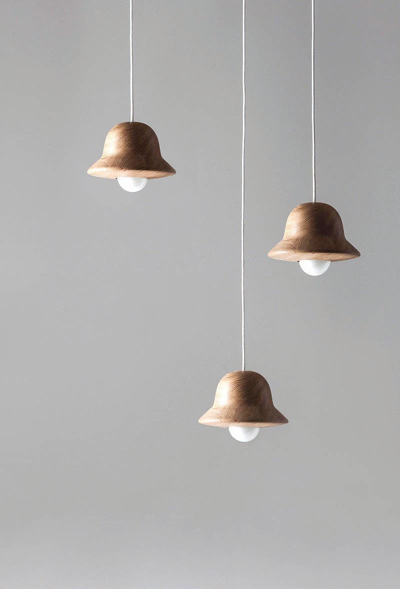 15 Wood Pendant Lights That Add A Natural Touch To Your Decor // These cute wood pendant lights were modeled after the hat blocks that milliners use to make hats.