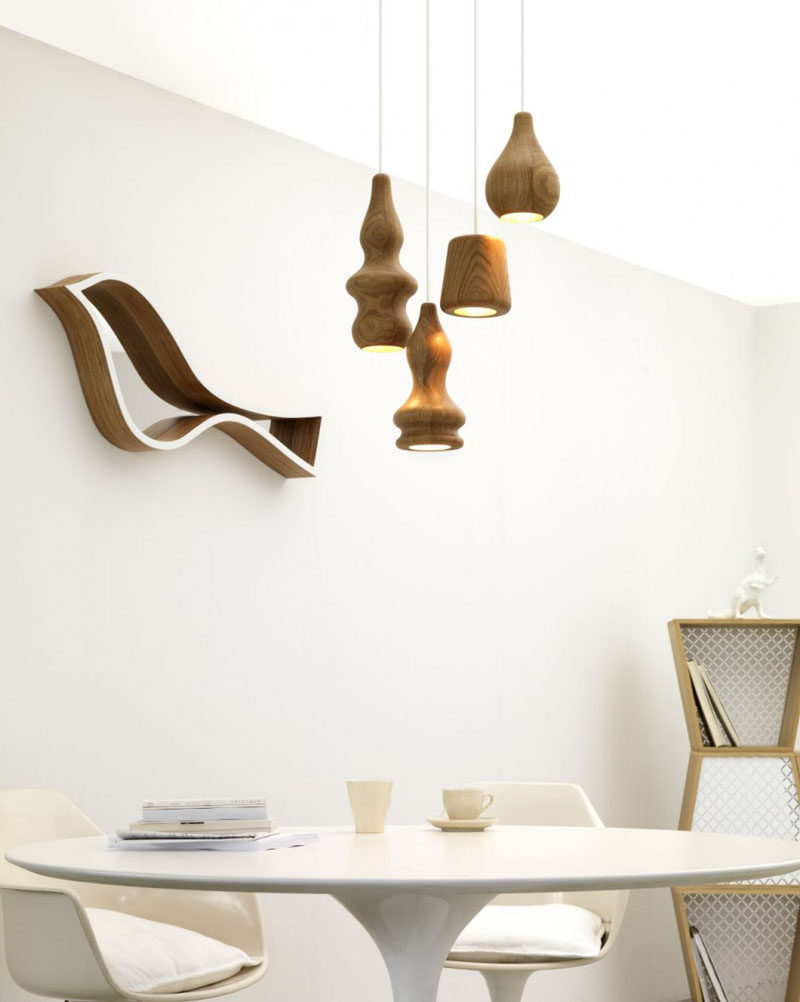 15 Wood Pendant Lights That Add A Natural Touch To Your Decor // Smooth light colored wood has been used to create these pendant lights in bulbous shapes.
