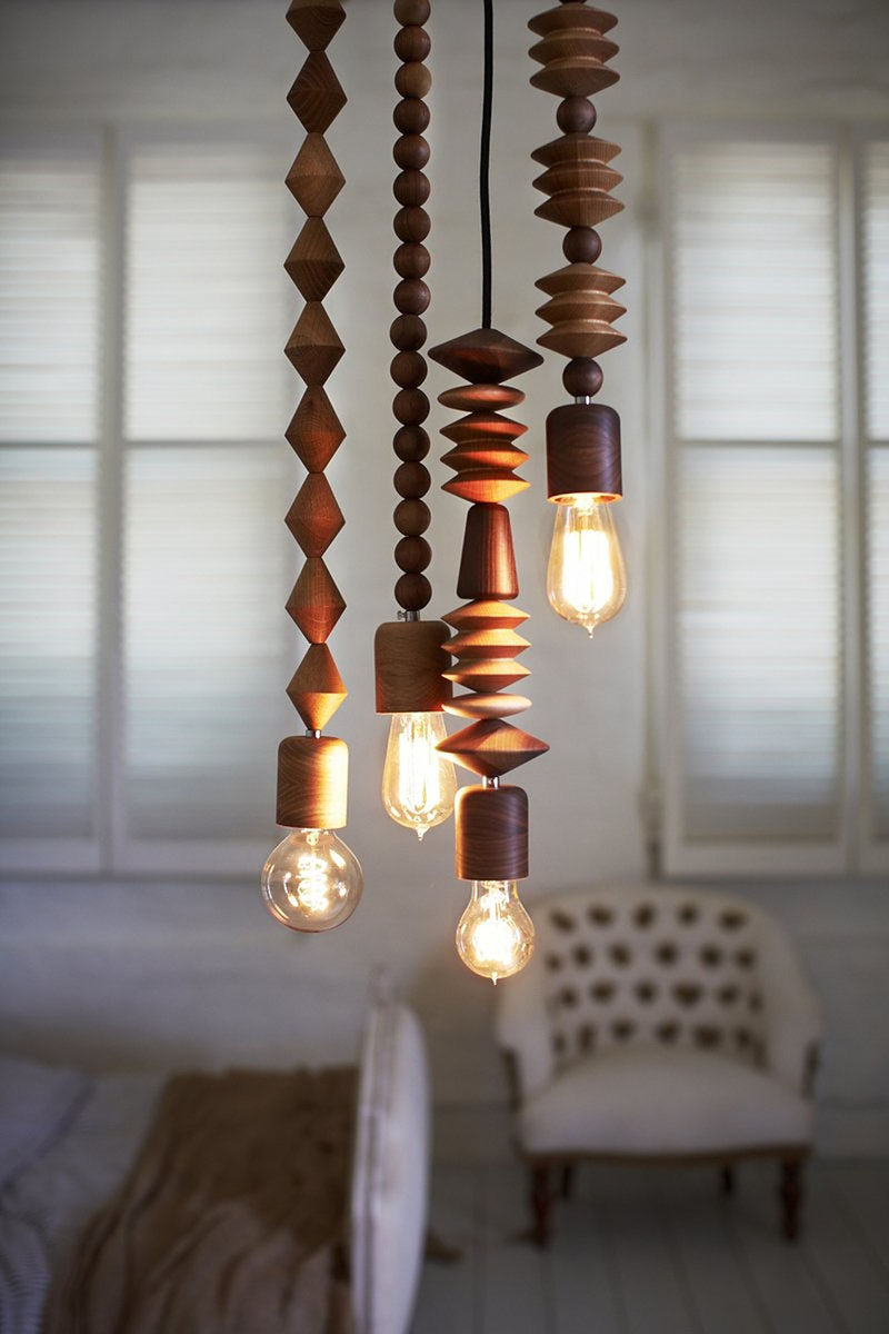 15 Wood Pendant Lights That Add A Natural Touch To Your Decor // Wood beads in various shapes and sizes make up these pendant lights.