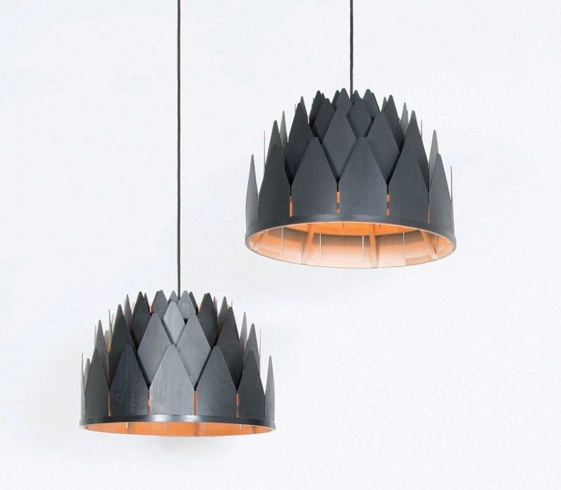 15 Wood Pendant Lights That Add A Natural Touch To Your Decor // These crown-like wood pendant lights are made from birch that's been stained black.