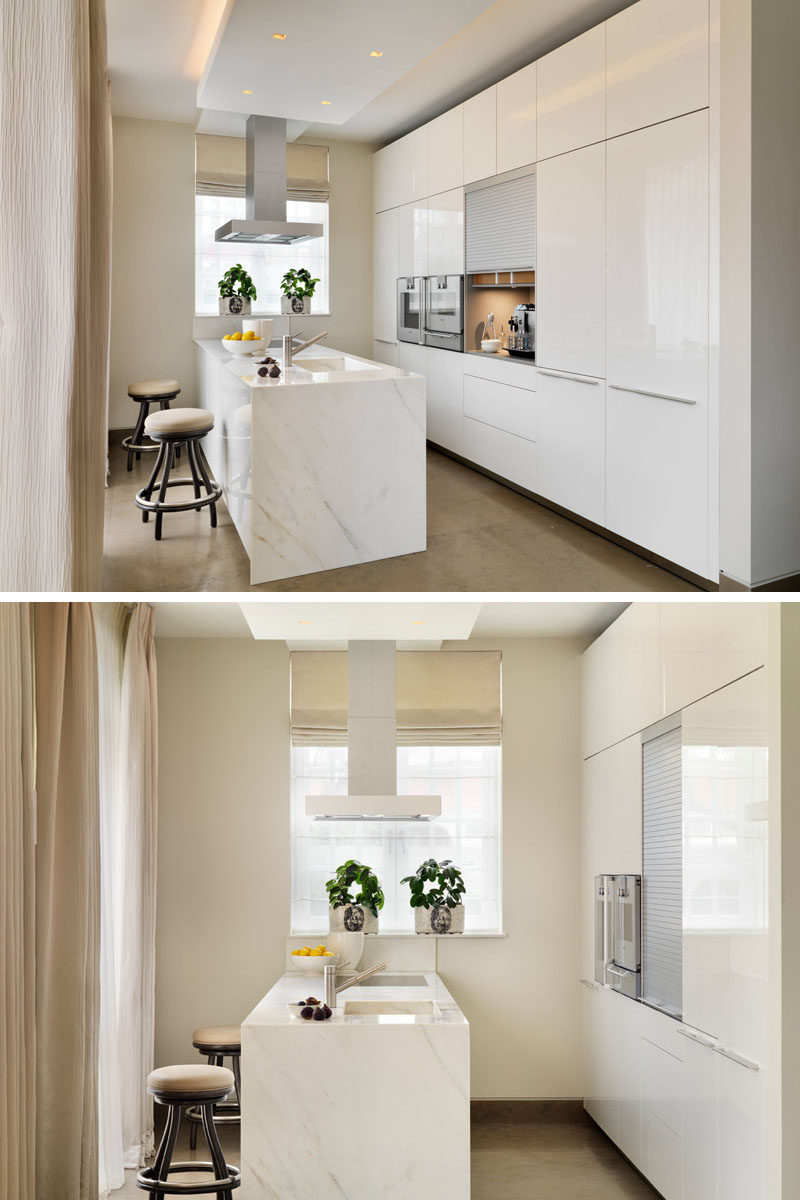 Kitchen Design Idea - Store Your Kitchen Appliances In A Dedicated Appliance Garage // The coffee machine and the accessories that go with it fit perfectly inside this well lit appliance garage with rolling door.  #ApplianceGarage #KitchenIdeas #KitchenDesign
