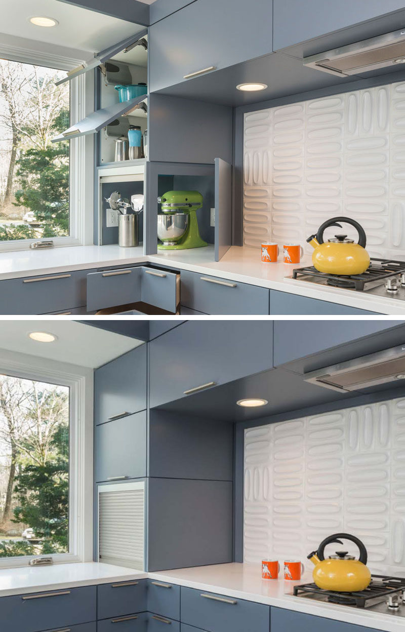 Kitchen Design Idea - Store Your Kitchen Appliances In A Dedicated Appliance Garage // The silver garage door slides up to reveal the inside of the appliance storage spot, while the blue cupboard door opens on the other side to provide even more access to the appliances when you need to use them.  #ApplianceGarage #KitchenIdeas #KitchenDesign