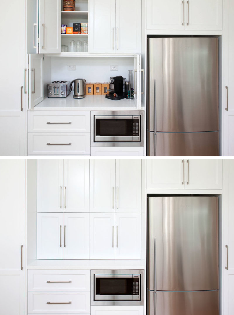 Kitchen Design Idea - Store Your Kitchen Appliances In A Dedicated Appliance // Folding doors hide the space above the microwave large enough to store multiple appliances and everything you need to make a comforting cup of tea.  #ApplianceGarage #KitchenIdeas #KitchenDesign