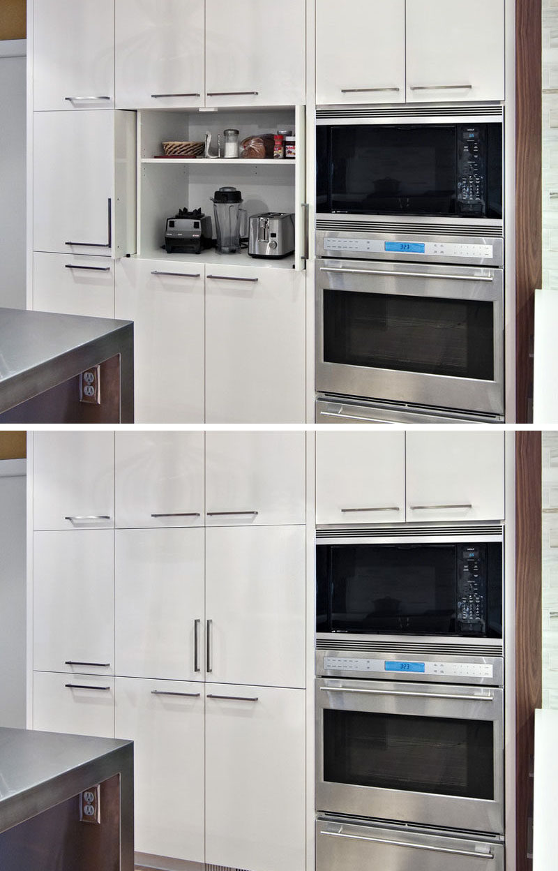 Kitchen Design Idea - Store Your Kitchen Appliances In A Dedicated Appliance Garage // This appliance garage is tall enough to include a second shelf that holds some of the things you'd likely need when using the appliances in the cupboard.  #ApplianceGarage #KitchenIdeas #KitchenDesign