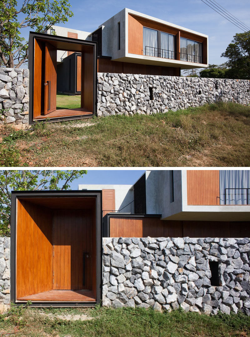In The Stone And Concrete Wall, Thereu0027s A Wood Door To Give You Access To  The Land Behind The House.
