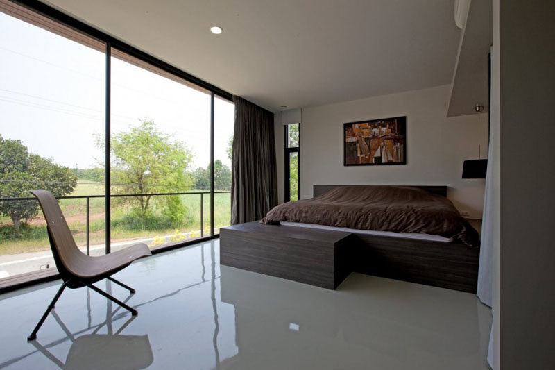 Large floor-to-ceiling windows provide plenty of light to this bedroom.