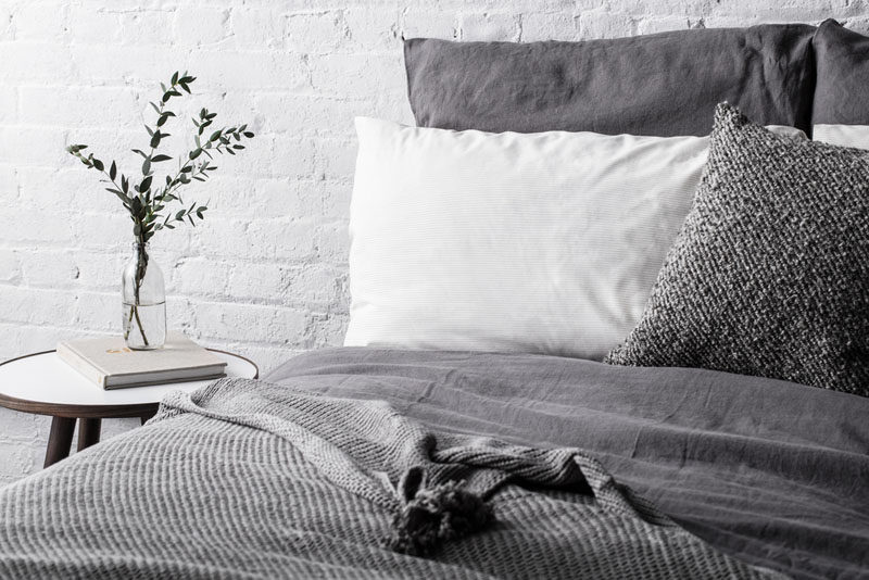 Bedroom Design Idea - 7 Ways To Create A Warm And Cozy Bedroom // Using pillows of different sizes, colors, and materials adds even more depth and texture to create an extra warm bedroom.