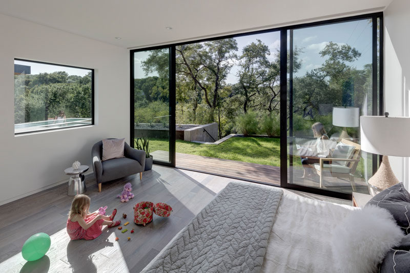 This bedroom has a double sliding door, allowing it to be completely open to the backyard and pool area.