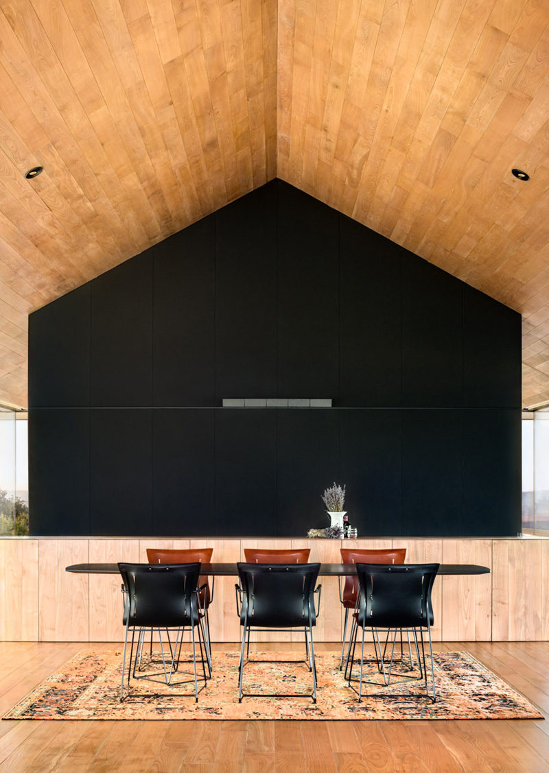A black feature wall makes a dramatic statement in this dining area.