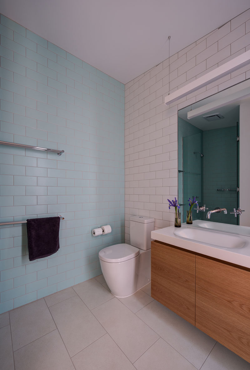 Light blue and white subway tiles cover the walls in this bathroom.