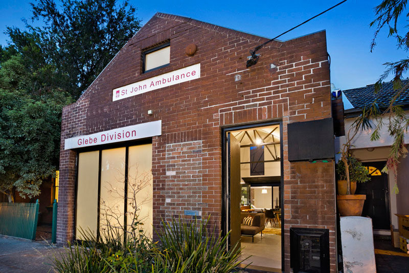 This former St. John's ambulance station in Sydney, Australia, has been transformed in an urban home with brick walls, vaulted ceilings and an open floor plan.