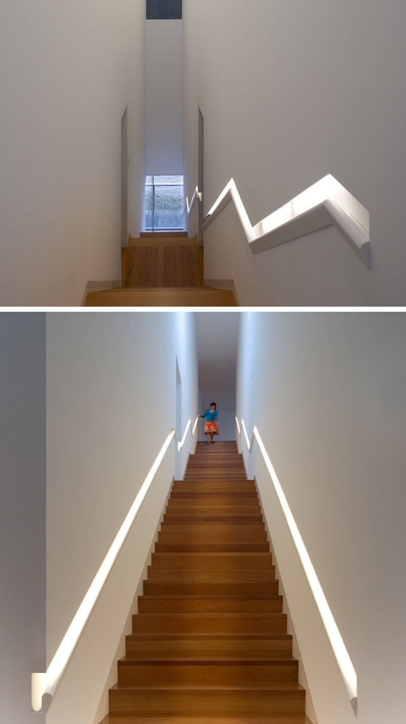 Stair Design Ideas - 9 Examples Of Built-In Handrails // This built-in handrail that runs the length of the stairs does double-duty as a light source.