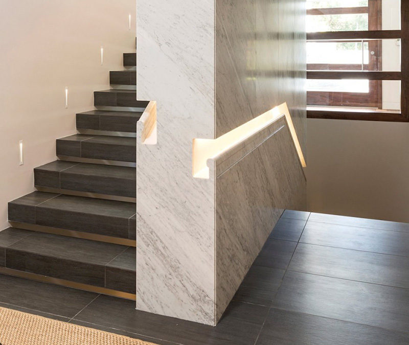 Stair Design Ideas - 9 Examples Of Built-In Handrails // In this home, the stair handrail was first built into the wall, which was then clad in marble. #BuiltInHandrail #HandrailIdeas #HandrailDesign #StairDesign #Handrails
