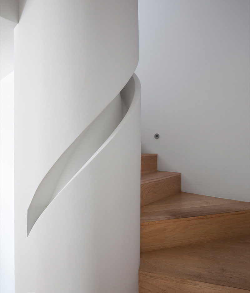 Stair Design Ideas - 9 Examples Of Built-In Handrails // A custom handrail has been built into the column that this staircase wraps around.