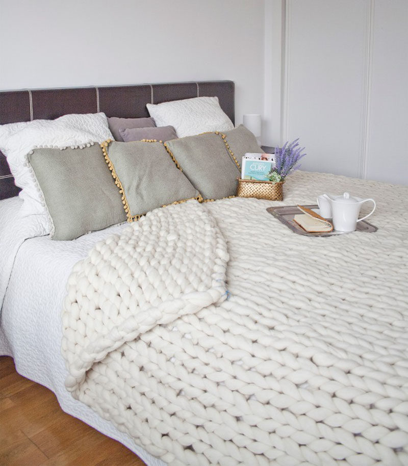 Bedroom Design Idea - 7 Ways To Create A Warm And Cozy Bedroom // Chunky blankets draped over the end of your bed or hanging on the back of a chair in your room also add a huge amount of texture and warmth to your space both figuratively and literally.