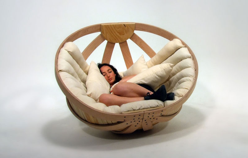 12 Comfy Chairs Perfect For Relaxing In // Thick fluffy cushions line the inside of this curved rocking chair to take your comfy-ness to the next level.