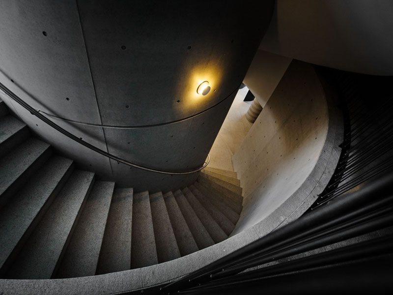 Spiraling concrete stairs lead you to the various floors of this clubhouse.