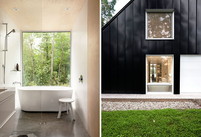 In this bathroom, a large window directly in front of the bath allows for an uninterrupted view of the outdoors.