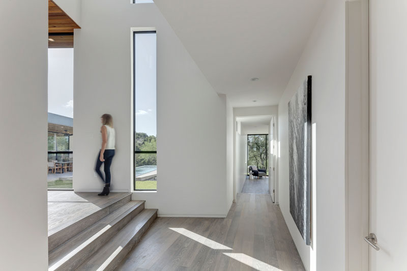 Light wood flooring has been used throughout this home and contrasts the white walls.