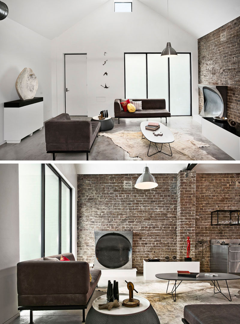 In this renovated living room, touches of the old ambulance station, like the brick wall, have been left in place to become a unique feature wall.