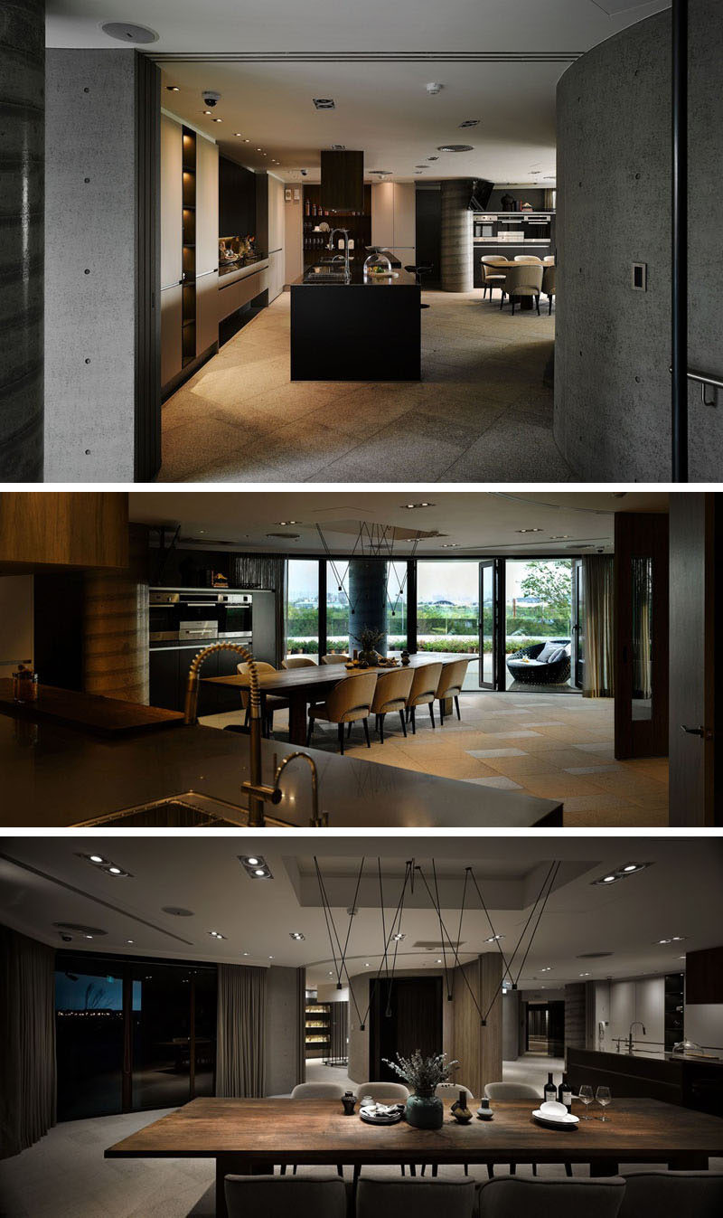 Throughout the various spaces of this clubhouse, materials like wood and concrete have been paired with dramatic lighting and natural elements to create a contemporary interior.