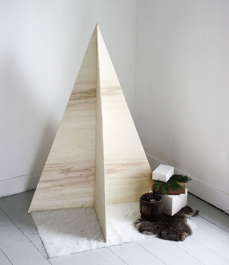 Christmas Decor Ideas - 14 DIY Alternative Modern Christmas Trees // Perfect for minimalists, this tree requires nothing more than two sheets of plywood and a saw.