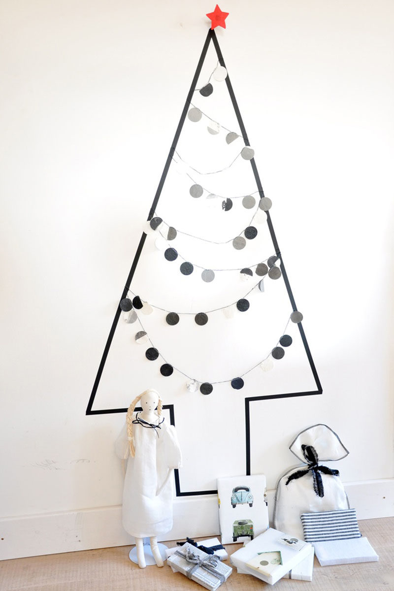 Christmas Decor Ideas - 14 DIY Alternative Modern Christmas Trees // This all black washi tape tree creates a minimal Christmas display that can be decorated or left empty and makes a spot perfect for piling up presents.