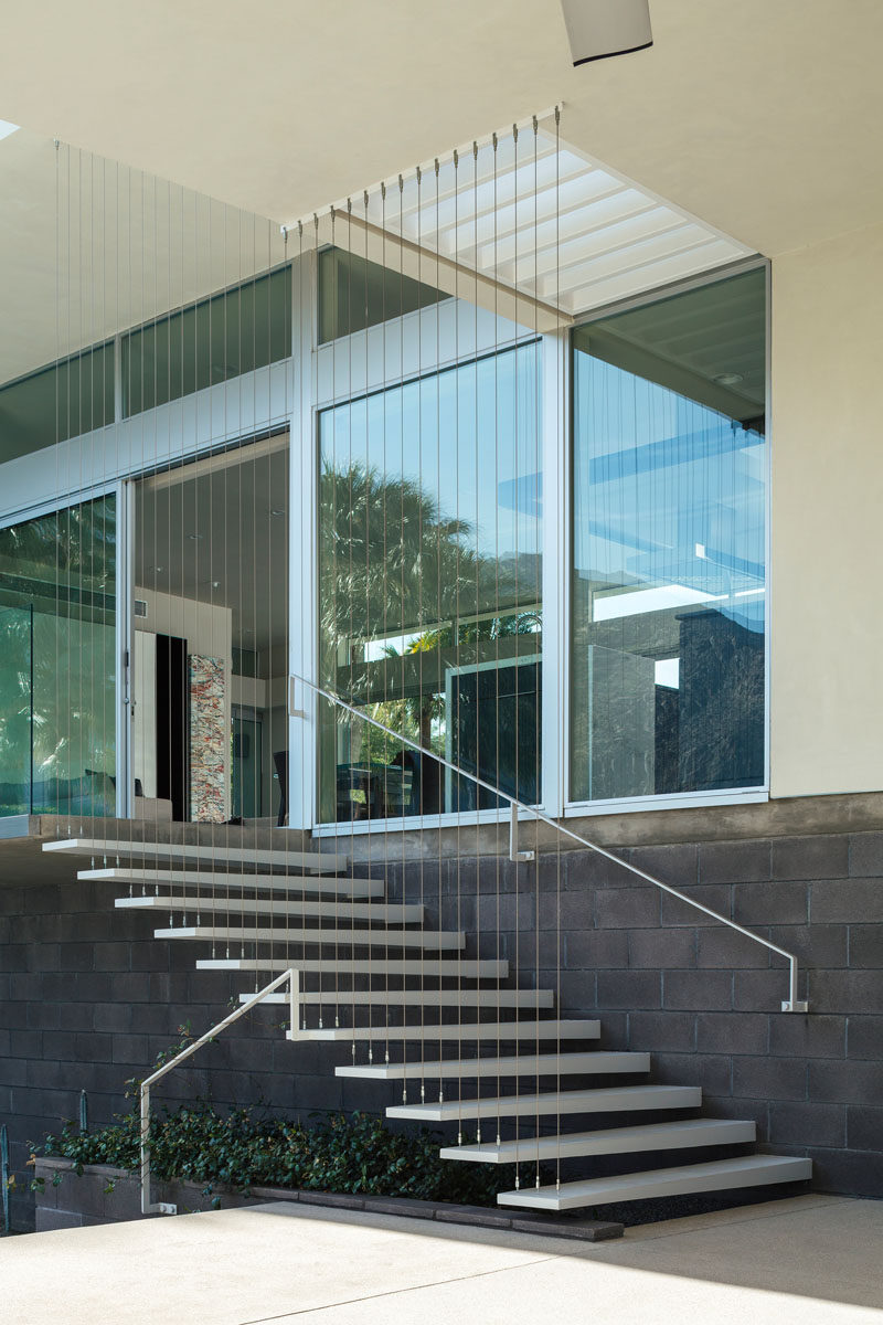 These exterior stairs lead you down from the main living area to an outdoor lounge and swimming pool, as well as the private master wing.