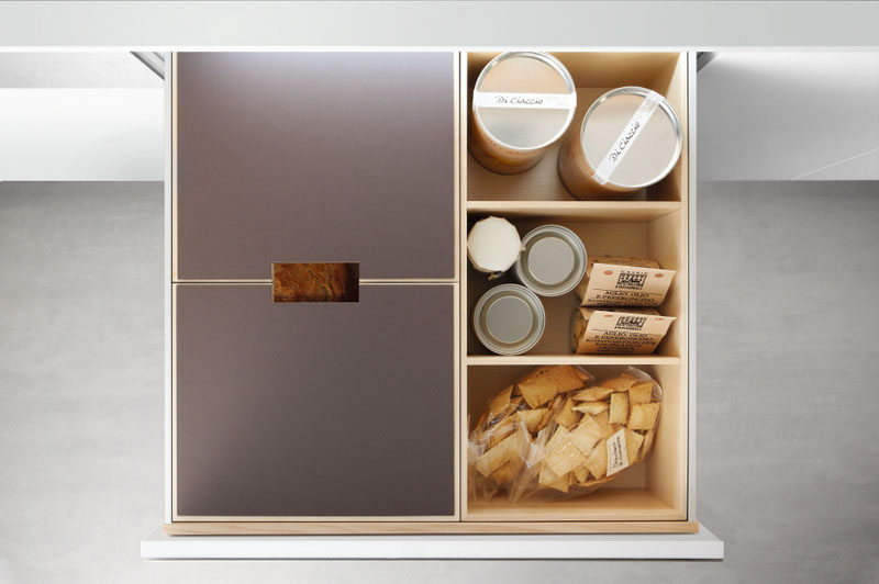 Kitchen Drawer Organization - Design Your Drawers So Everything Has A Place // This drawer has a covered spot perfect for storing loaves of bread as well as divided sections for storing other bits of food.
