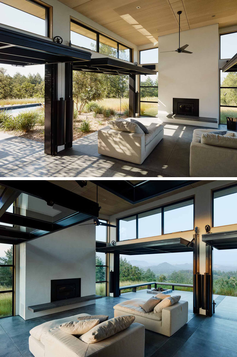 Four oversized glass panels open on a pulley system on each side of this main living room, to create a dramatic effect and allow for indoor/outdoor living, as well as assisting with air flow on a hot day.