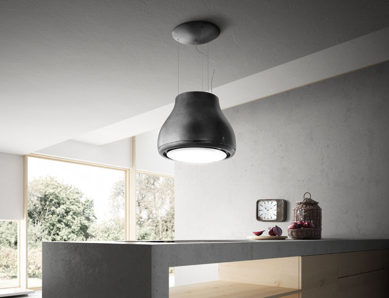 Kitchen Design Idea - Hide The Range Hood // This range hood is surrounded by a light fixture. A charcoal filter filters out the smoke, odors, and steam purifying the air as it flows out the top. Watch the video below to see it in action.