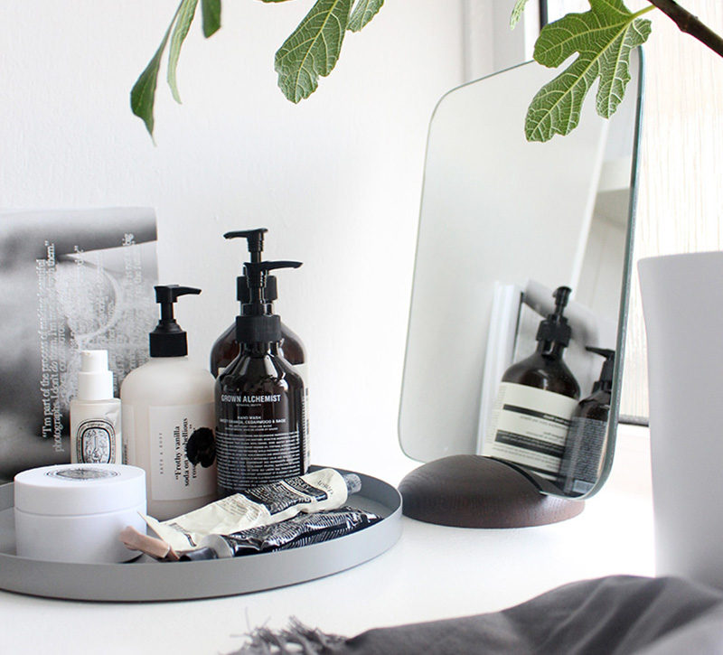 Home Decor Ideas - 6 Ways To Use Serving Trays In Your Decor // In the bathroom, decorated with soaps, moisturizers and perfume.