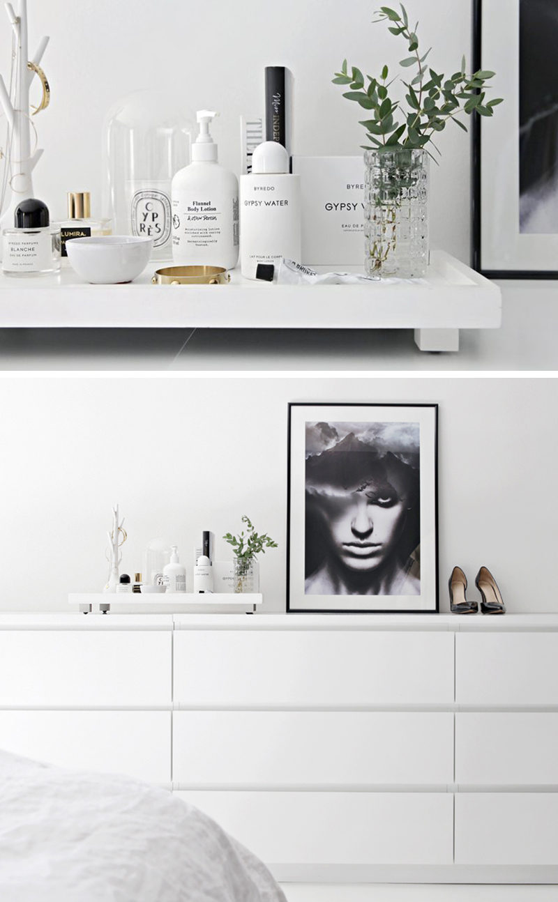 Home Decor Ideas - 6 Ways To Use Serving Trays In Your Decor // In the bedroom, decorated with a perfumes, creams, a vase and jewelry.