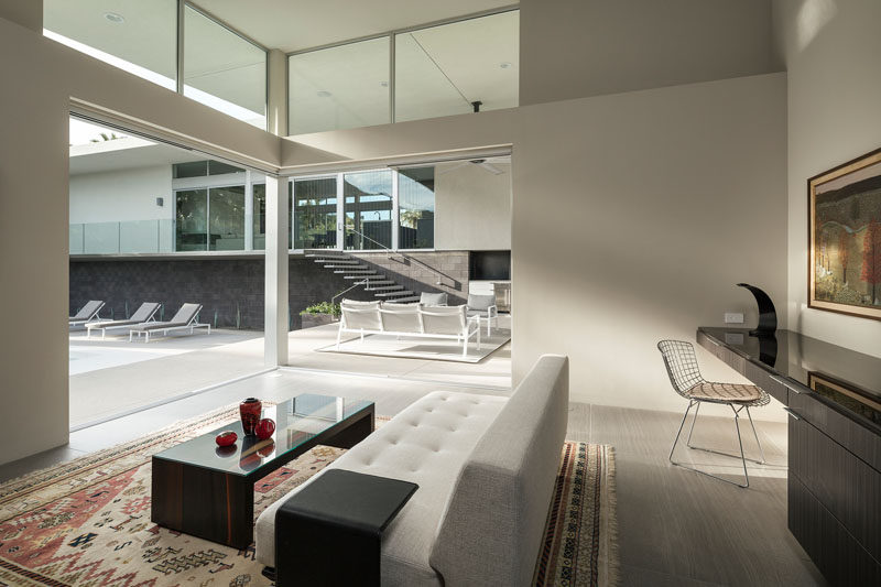 This home office opens up to an outdoor lounge and swimming pool.