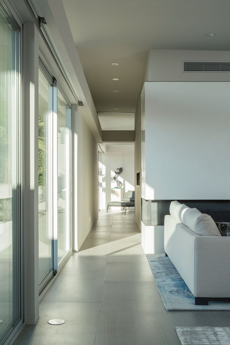 Just off the side of this living room is a hallway that takes you to a bedroom.