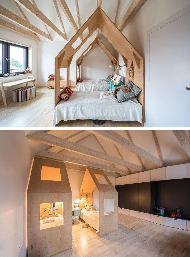 This kids bedroom has each bed enclosed within its own little house.