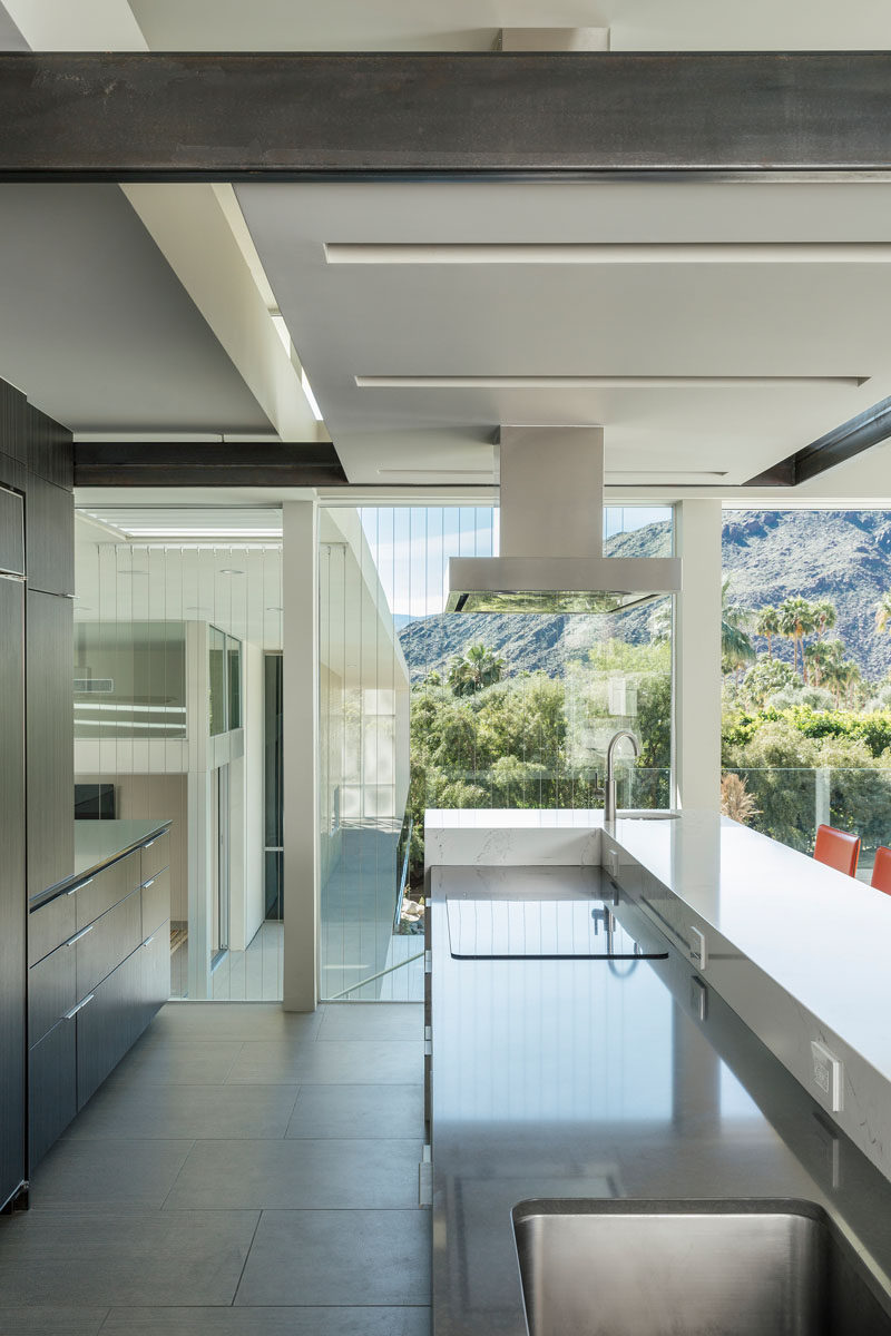 This kitchen with undermount sink has views of the mountains.