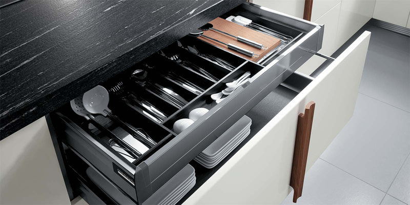 Kitchen Drawer Organization - Design Your Drawers So Everything Has A Place // Cutlery and other frequently used utensils sit in this organized top drawer and are easy to grab when you need them.