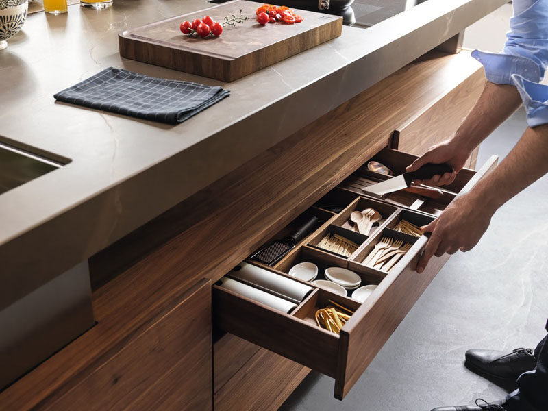 Kitchen Drawer Organization - Design Your Drawers So Everything Has A Place // The knives in this drawer are tucked into the protectors and rest on an elevated piece of wood to create a gap that makes picking them up much easier.