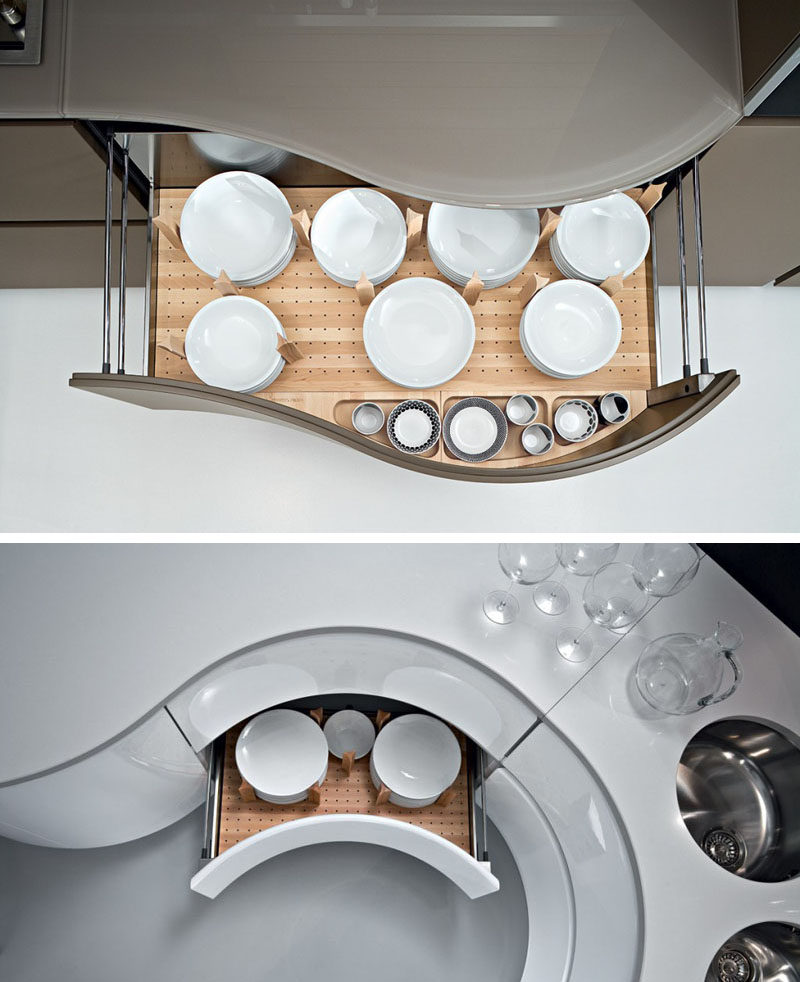 Kitchen Drawer Organization - Design Your Drawers So Everything Has A Place // Dowels with curved edges hug the sides of these plates to create a snug spot for the plates and to keep them from moving around as the drawers open and close.