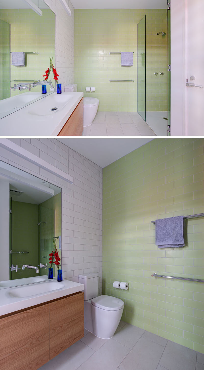 Pastel green subway tiles cover the wall in this contemporary bathroom.