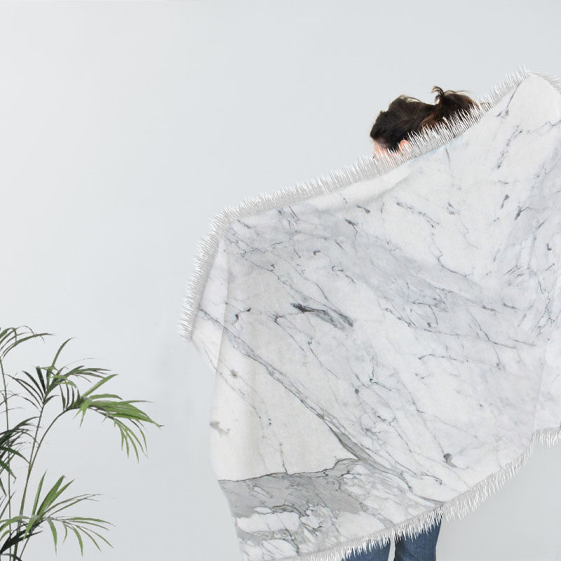 Interior Design Idea - 7 Ways To Bring A Touch Of Marble To Your Living Room // Marble Blanket