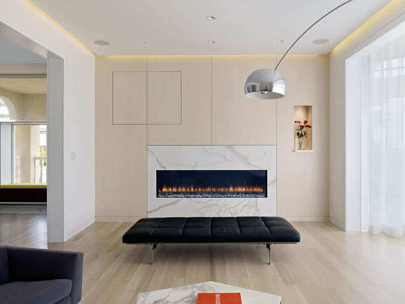 Interior Design Idea - 7 Ways To Bring A Touch Of Marble To Your Living Room // Marble Fireplace Surround