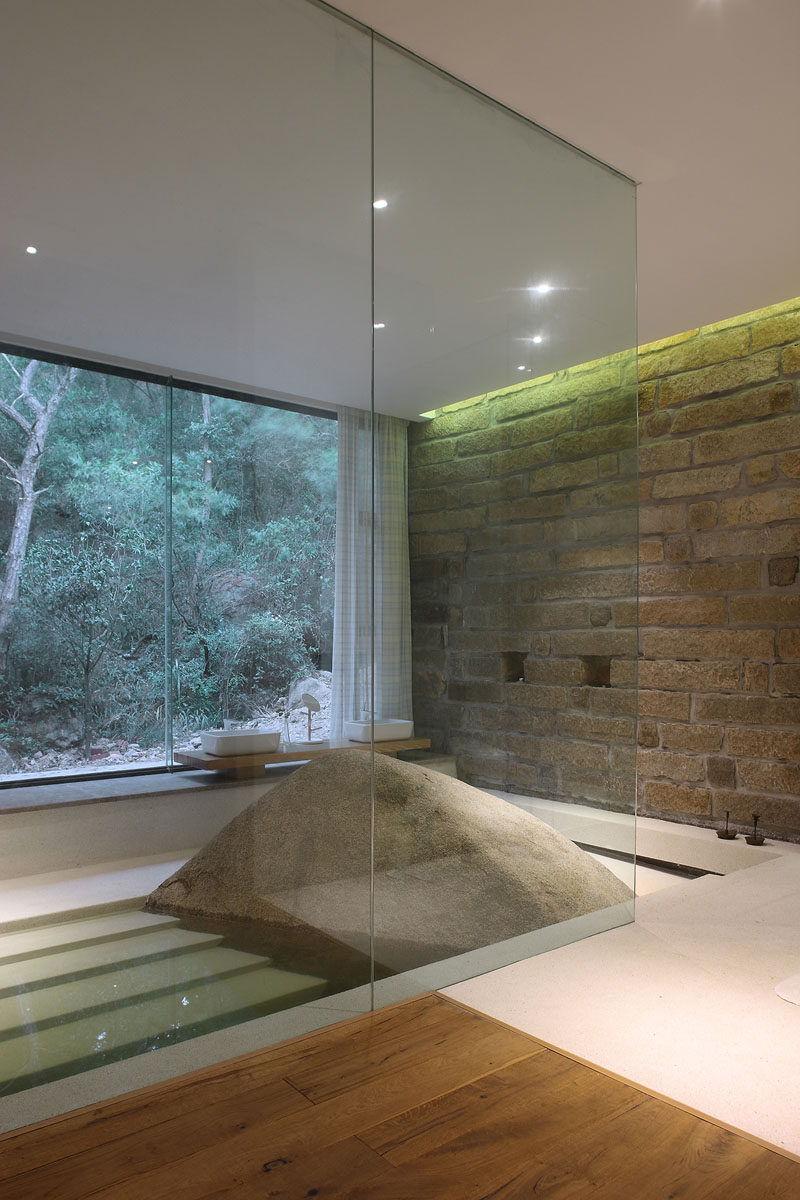 This master bath was build around a naturally occurring boulder.