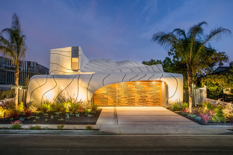 Designer, builder and artist Mario Romano, has completed 'The Wave House', a home in Venice, California, that features a cascading white aluminum skin.