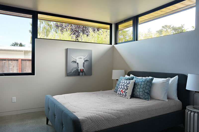 The windows in this bedroom follow the roof line and provide an abundance of natural light.