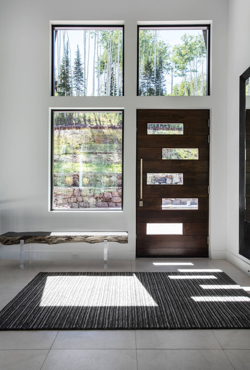 Entryway Design Ideas - 3 Different Styles Of Entryway Benches // This bright entryway is made to feel a little cozier with the help of this raw edge wood bench.